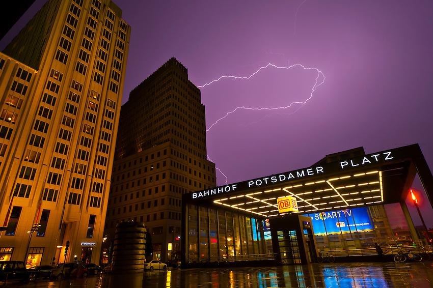 Lightning over the Bahnhof Potsdamer Platz and the Ritz-Carlton Hotel (on left), Mitte, Berlin, Germany
