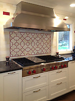 This custom kitchen designed by Cindy Leff for Fancy Fixtures features a Chatham 3 mosaic backsplash shown in Quartz and Ruby jewel glass.<br />