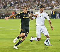 LOS ANGELES, CA – July 16, 2011: Adam Cristman (17) of the LA Galaxy and Raphael Varane (19) of Real Madrid during the match between LA Galaxy and Real Madrid at the Los Angeles Memorial Coliseum in Los Angeles, California. Final score Real Madrid 4, LA Galaxy 1.