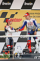 May 2, 2010 - Jerez, Spain -  Spanish riders Dani Pedrosa and Jorge Lorenzo celebrate on the podium at the end of the MotoGP race at Circuito de Jerez on May 2, 2010 in Jerez de la Frontera, Spain. (Photo Andrew Northcott/Nippon News).