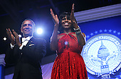 United States President Barack Obama and first lady Michelle Obama applaud the crowd during the Inaugural Ball January 21, 2013 at Walter E. Washington Convention Center in Washington, DC. Barack Obama was re-elected for a second term as President of the United States.  .Credit: Alex Wong / Pool via CNP