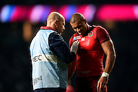 Jonathan Joseph of England is treated for an injury during a break in play. Rugby World Cup Pool A match between England and Fiji on September 18, 2015 at Twickenham Stadium in London, England. Photo by: Patrick Khachfe / Onside Images