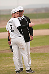 Vale pitcher Kyle Barras confers with head coach Rick Yraguen before the start of the seventh inning against Nyssa on April 15, 2011. Barras pitched a seven inning complete game, striking out thirteen and picking up the win as Vale prevailed 4-1.