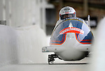 15 December 2007: Japan 1 pilot Manami Hino, with Tomoe Satoh on the brakes, head down the straightaway towards Turn 16 during their second run of the FIBT World Cup Bobsled Competition at the Olympic Sports Complex on Mount Van Hoevenberg, at Lake Placid, New York, USA. ..Mandatory Photo Credit: Ed Wolfstein Photo