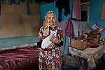 _2SM0811; Karelia, Russia; 06/2012; RUSSIA-10044NF.  An elderly woman holds her cat.<br />