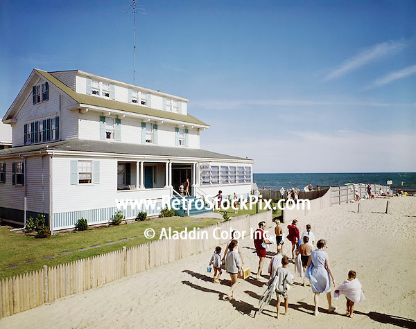 By The Sea Hotel in Dennisport, Mass. Families walking to the beach. 1960's