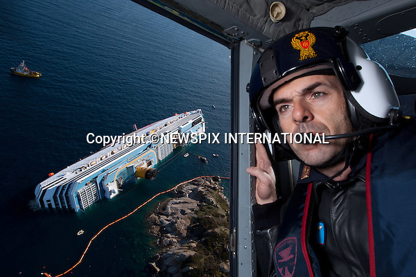 """Isola del Giglio, Italy_18/01/2012:  COSTA CONCORDIA DISASTER.The Costa Concordia that ran aground the Isola del Giglio, is slowly sinking as rescue workers try to locate the missing passengers..The Costa Concordia, which was carrying more than 4,000 passengers, ran aground a few hundred metres from the tiny Tuscan holiday island of Giglio on Friday evening as the passengers were at dinner, after apparently sailing off course..The owners have accused Captain Francesco Schettino of causing the accident..Mandatory Credit Photo: ©Sestini/NEWSPIX INTERNATIONAL..**ALL FEES PAYABLE TO: """"NEWSPIX INTERNATIONAL""""**..IMMEDIATE CONFIRMATION OF USAGE REQUIRED:.Newspix International, 31 Chinnery Hill, Bishop's Stortford, ENGLAND CM23 3PS.Tel:+441279 324672  ; Fax: +441279656877.Mobile:  07775681153.e-mail: info@newspixinternational.co.uk"""