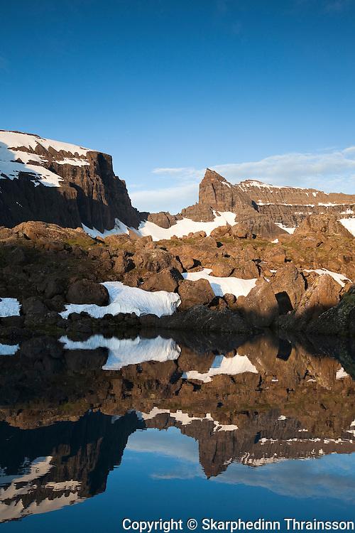 Mt. Dyrfjöll (1.136m) reflecting in Stórurð, east Iceland