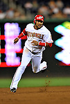 16 August 2008: Washington Nationals' infielder Emilio Bonifacio heads to third during a game against the Colorado Rockies at Nationals Park in Washington, DC.  The Rockies defeated the Nationals 13-6, handing the last place Nationals their 9th consecutive loss. ..Mandatory Photo Credit: Ed Wolfstein Photo
