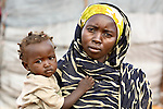 A displaced mother and child in the Dereig camp outside Nyala.