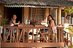 Girls in beach hut, Palawan, Philippines