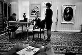 Moscow, Russia<br /> 1996<br /> <br /> Vladimir Brynstalov is proud of the millions he has earned in running the largest pharmaceutical company in the former Soviet Union. Here he is seen purchasing a $40,000 bottle of French wine in his office with the portrait of his wife and child on the walls.