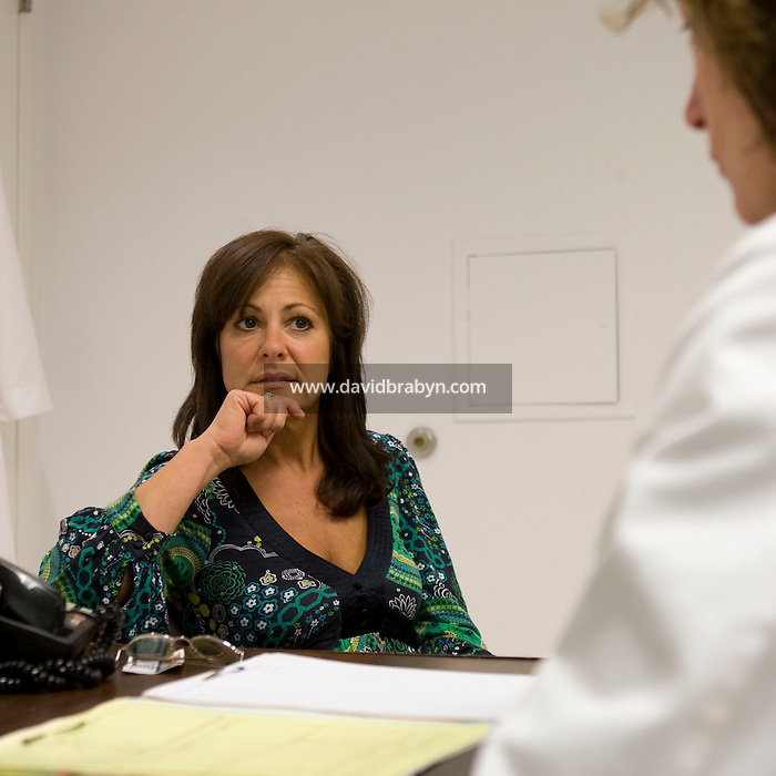 Employee and former smoker Marianna Labella (L) talks to nurse practitioner Mary Sullivan during an appointment in the health center at the Pitney Bowes headquarters in Stamford; CT; United States; 7 October 2008.