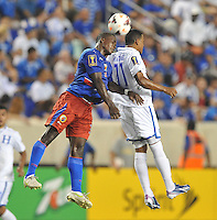 Rony Martinez (11) of Honduras heads the ball against Mechack Jerome (3) of Haiti.  Honduras defeated Haiti 2-0 in the first round of the CONCACAF Gold Cup, at Red Bull Arena, Monday July 8 , 2013.