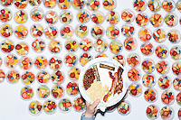 A person carries their plate of bacon, sausage, beans, and eggs, over cups of fruit at the New Hampshire AFL-CIO Labor Day Breakfast at the St. George Greek Orthodox Cathedral in Manchester, New Hampshire. Democratic presidential candidates Bernie Sanders and Lincoln Chafee spoke at the event.