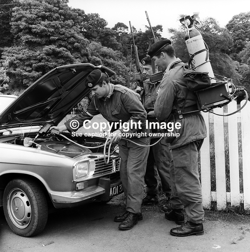 British soldiers serving in N Ireland demonstrate a device for detecting gelignite. Has the appearance of a prototype. 1st July 1971. 197107010254<br /> <br /> Copyright Image from Victor Patterson, 54 Dorchester Park, Belfast, UK, BT9 6RJ<br /> <br /> t1: +44 28 9066 1296<br /> t2: +44 28 9002 2446<br /> m: +44 7802 353836<br /> <br /> e1: victorpatterson@me.com<br /> e2: victorpatterson@gmail.com<br /> <br /> www.victorpatterson.com<br /> <br /> <br /> <br /> <br /> <br /> m: +44 7802 353836<br /> vm +44 20 8816 7153<br /> <br /> e1: victorpatterson@me.com<br /> e2: victorpatterson@gmail.com<br /> <br /> www.victorpatterson.com<br /> <br /> IMPORTANT: Please see my Terms and Conditions of Use at www.victorpatterson.com