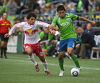New York Red Bulls midfielder Mehdi Ballouchy and Seattle Sounders FC defender Leonardo Gonzalez  battle for the ball during play at Qwest Field in Seattle Saturday June 23, 2011. The Sounders won the game 4-2.