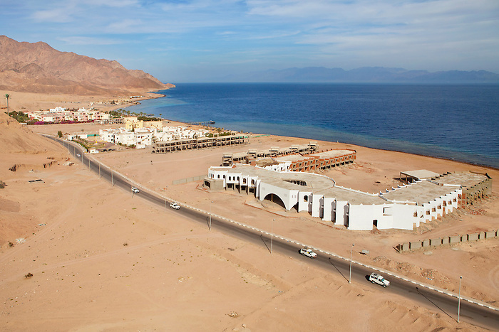Dahab, Sinai, February 2015. In the foreground is a tourist village left unfinished. The site has been abandoned since the 2011 revolution. The investors are still hesitating to get the construction going again. Each tourist village are built as enclosed units where the entrance and exits are secured in order to protect the tourists.