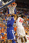 UK freshman forward Willie Cauley-Stein tries to dunk the ball against UF junior guard Casey Prather during the second half of the University of Kentucky vs. University of Florida men's basketball game at the O'Connell Center in Gainesville, Fl., on Tuesday, February 12, 2013. UK lost 69-52. Photo by Tessa Lighty | Staff