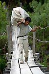 A boy crosses the Agusan River near Tandawan in Mindanao, Philippines.