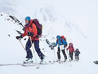Skiløpere i snøvær på vei opp Markusdalen mot Svartfjelljøkelen i Loppa. ---- Skiers in mountain terrain.