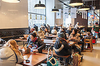 Shoppers in the new Whole Foods Market opposite Bryant Park in New York on opening day Saturday, January 28, 2017. The store in Midtown Manhattan is the chain's 11th store to open in the city. The store has a large selection of prepared foods from a diverse group of vendors inside the store.  (© Richard B. Levine)