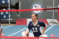 USA Paralympic sitting volleyball team member Nicole Millage participates in a demo of the sport at the Road to London 100 Days Out Celebration in Times Square in New York City, New York, USA on Wednesday, April 18, 2012.  Times Square was transformed into an Olympic Village for the event.
