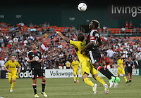 WASHINGTON, DC - AUGUST 4, 2012:  Brandon McDonald (4) of DC United leans into the back of Carlos Mendes (4) of the Columbus Crew during an MLS match at RFK Stadium in Washington DC on August 4. United won 1-0.