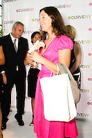 Prize winner accepts gift at the CURVE and CFDA Party For A Cause event during the CURVENY Lingerie & Swim show, at the Jacob Javits Convention Center, August 2, 2010.