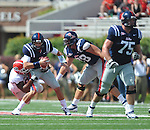 Ole Miss' Zack Stoudt (8) is sacked at Vaught-Hemingway Stadium in Oxford, Miss. on Saturday, September 24, 2011. The play, a touchdown, was called back due to penalty. Georgia won 27-13.
