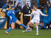 Rosie White (13) of UCLA fights for the ball with Isabella Schmid (11) of Florida State during the NCAA Women's College Cup finals at WakeMed Soccer Park in Cary, NC.  UCLA defeated Florida State, 1-0, in overtime.