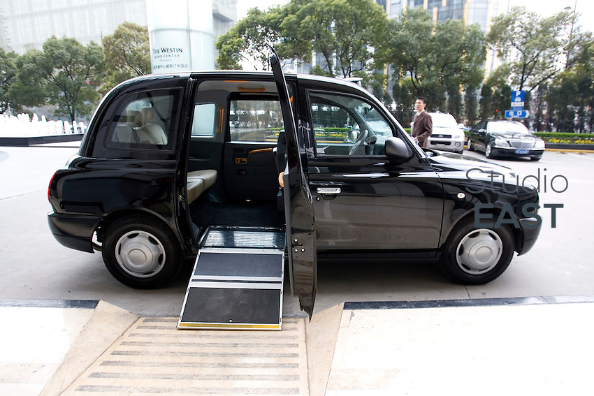 A 'black cab' includes an easy access ramp for wheelchairs, in Shanghai, China, on March 23, 2009.  London Taxi International, the producer of London Taxi's famed black cabs, turned to China to drive overseas expansion. More than 8,000 London Taxis will be produced from the Chinese factory, more than double the annual output of the firm's historical factory plant in Conventry, England. Most of these cars will go to places like Singapore, Dubai, Moscow, that covet the image associated with the London Taxis' tradition of good service and durability. London Taxi International will continue to build 90 percent of the Taxi cabs used in Britain at Coventry. Photo by Lucas Schifres/Pictobank