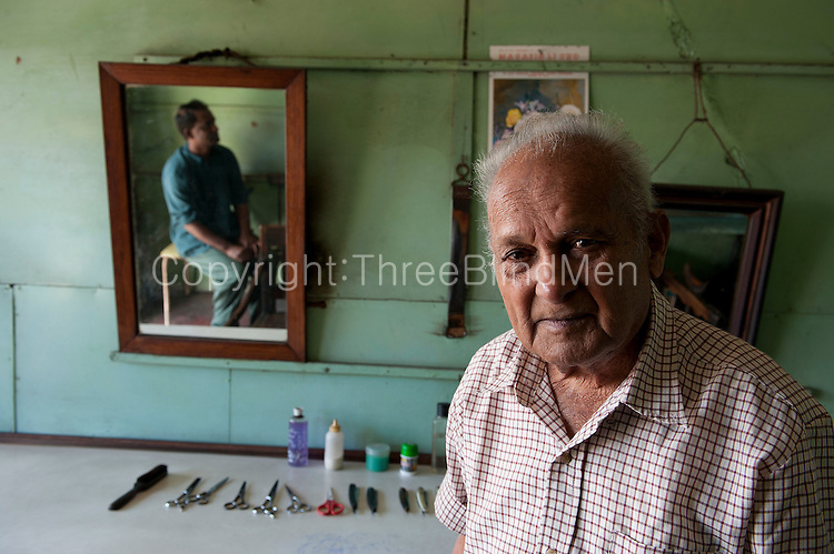 Mr. Gopaul, barber, in his salon.