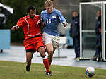 Virginia's Zola Short (15) and UNC's Ben Hunter (11) on Sunday, November 27th, 2005 at Fetzer Field in Chapel Hill, North Carolina. The University of North Carolina Tarheels defeated the University of Virginia Cavaliers 2-1 in a NCAA Men's Soccer Tournament Round of 16 game.