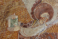 Detail of Matthew the Apostle, 12th century frescoes in the choir of the Pre-Romanesque Chapel of Saint Martin de Fenollar (Sant Marti de Fenollar), 9th century, Maureillas Les Illas, Pyrenees Orientales, France. The frescoes are an outstanding piece of work, which greatly impressed modern artists, especially Pablo Picasso and Georges Braque in 1910. Picture by Manuel Cohen