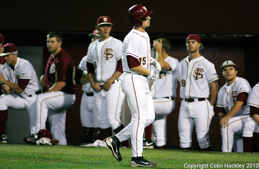 TALLAHASSEE, FL 3/12/10-FSU-UV BASE10 CH30-Florida State's Tyler Holt walks to the dug out after flying out in the ninth inning against Virginia Friday at Dick Howser Stadium in Tallahassee. The Cavaliers broke the Seminoles 2010 12 game winning streak beating them 5-0...COLIN HACKLEY PHOTO