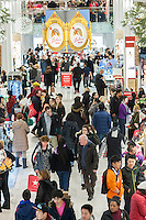 Shoppers in the Macy's Herald Square flagship store in New York looking for bargains on Black Friday, the day after Thanksgiving, Friday, November 29, 2013. Many retailers, including Macy's, opened their doors on Thanksgiving or opened up for Black Friday the night before extending the shopping day into over 24 hours. (© Richard B. Levine)