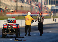 May 18, 2014; Commerce, GA, USA; NHRA top fuel driver Bob Vandergriff yells at members of the Safety Safari about track conditions during the Southern Nationals at Atlanta Dragway. Mandatory Credit: Mark J. Rebilas-USA TODAY Sports