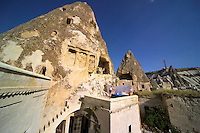 Goreme, Cappadocia, Turkey, July 2005. Jillian hangs the laundry on the roof terrace underneath the Roman grave and the byzantine chapel. Dutch Photographer Frits Meyst and his wife Jillian Macdonald restored an old rock house in the village of Goreme. Since Roman Times people have been cutting graves and home out of the Soft tufo 'Fairy Chmney' rocks of Cappadocia. Photo by Frits Meyst / MeystPhoto.com