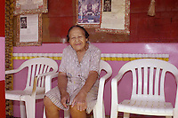 Miss Margaret relaxes at home. Pictures is Miss margaret's Grocery, also known as Rev.Dennis's Castle, in Vicksburg Mississippi. Located on the Blues Highway, HWY 61 North, this folk art Palace is in recent times in need of repair. A non profit is being set up to help preserve the property since Miss Margaret's death in 2008. rev. Dennis is now in nursing home and 94 yrs. old. His works of art and bus he lovingly turned into a church with Margaret's help need to be protected for future generations to enojy. Photo©SuziAltman