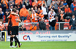 Dundee United v St Johnstone...24.08.13      SPFL<br /> Andrew Robertson and Paul Paton hug at full time<br /> Picture by Graeme Hart.<br /> Copyright Perthshire Picture Agency<br /> Tel: 01738 623350  Mobile: 07990 594431