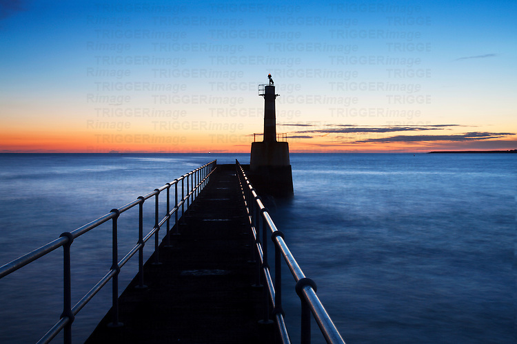 Harbour Light Silhouette against Dawn Sky Amble by the Sea Northumberland England