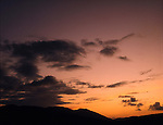 Silhouetted mountain against pink sky.South Pacific.