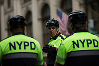 NEW YORK, NY - APRIL 15: NYPD officers wait instructions as activists take part in a Tax Day protest on April 15, 2017 in New York City. Thousands of activists march to Trump Tower to demand that President Donald Trump release his tax returns. Photo by VIEWpress/Eduardo MunozAlvarez