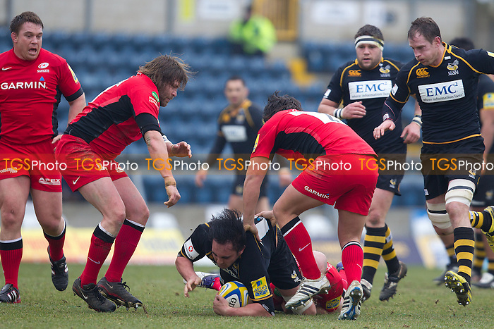 Jonathon Poff of London Wasps RFC can'f find a way through Carlos Nieto and Jamie Goerge (c) of Saracens RFC - London Wasps RFC vs Saracens RFC - Aviva Premiership Rugby at Adams Park, Wycombe Wanderers FC - 12/02/12 - MANDATORY CREDIT: Ray Lawrence/TGSPHOTO - Self billing applies where appropriate - 0845 094 6026 - contact@tgsphoto.co.uk - NO UNPAID USE.