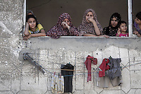 "August 26, 2014 - Gaza City, Gaza strip, Palestinian Territory: Palestinian residents look at an apartment complex buildiing after it was targeted by an airstrike raid in central Gaza City as ""Protective Edge"" Israeli military operation continues in the Gaza strip. (Narciso Contreras/Polaris)"