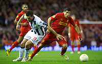LIVERPOOL, ENGLAND - Thursday, October 4, 2012: Liverpool's Luis Alberto Suarez Diaz in action against Udinese Calcio's Maurizio Domizzi during the UEFA Europa League Group A match at Anfield. (Pic by David Rawcliffe/Propaganda)