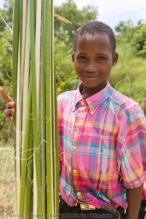 Papyrus reed and children, Kibale, Uganda, East Africa