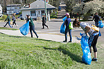 Ashley Mclean, front, picks up trash with other volunteers during Athens Beautification Day on April 9, 2017.
