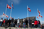 Danish and Greenland flags above people waiting to glimpse the Danish Royal Family, National Day, celebrating Self Governance, Nuuk, Greenland. From June 21 2009, Greenland moves from being under 'home rule' to 'self-governance' in a ceremony attended by the Danish Royal family and other heads of state.